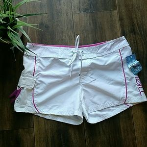 White n pink swim board shorts